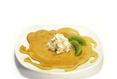 Pancakes filled with whipped cream and kiwi Stock Images