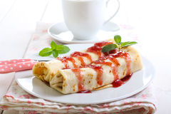 Pancakes with filling and berry sauce Stock Photos