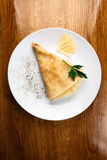 Pancakes with fillings. cheese. White plate Royalty Free Stock Image