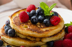 Pancakes with forest fruit and mint Royalty Free Stock Photos