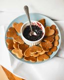 Pancakes. In the form of heart with jam Stock Photography