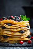 Pancakes with fresh berries and maple syrup on dark background. Closeup royalty free stock photos