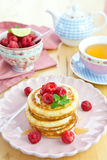 Pancakes with fresh berries Stock Images