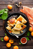 Pancakes with fresh blackcurrant and apricot jam Royalty Free Stock Photos