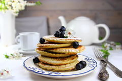 Pancakes with fresh blueberries and flowers Stock Photo