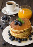 Pancakes with fresh blueberries and honey Royalty Free Stock Photography