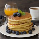Pancakes with fresh blueberries and honey Stock Image
