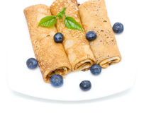 Pancakes and fresh blueberries on a white background Royalty Free Stock Photos