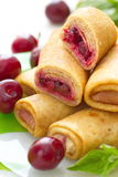 Pancakes with fresh cherries. Sweet pancakes with fresh cherries Stock Image