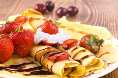 Pancakes and fresh fruit Stock Photos