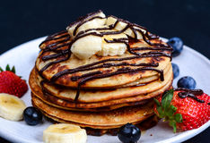 Pancakes with fresh fruits and chocolate stock image