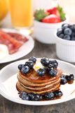 Pancakes. Fresh fruits, juice and eggs with bacon stock photo