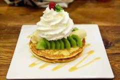Pancakes with fresh giwi,banana and whipcream Stock Photo