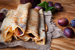 Pancakes and fresh plum jam Royalty Free Stock Images
