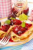 Pancakes with fresh plum`s confiture Stock Photography