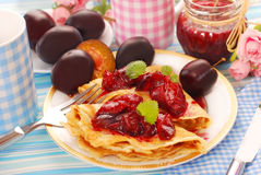 Pancakes with fresh plum`s confiture Stock Photo