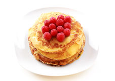Pancakes with fresh raspberries Royalty Free Stock Photography