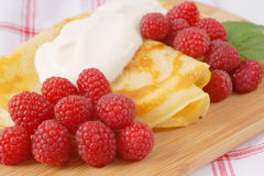 Pancakes with fresh raspberries Stock Photography