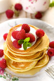 Pancakes with fresh raspberries and creamy soft cheese. Delicious and nutritious breakfast or dessert Stock Photography