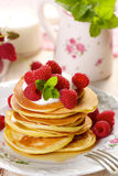 Pancakes with fresh raspberries and creamy soft cheese. Stock Photography