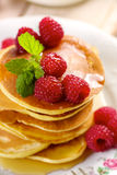 Pancakes with fresh raspberries and maple syrup Royalty Free Stock Images