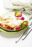 Pancakes with fresh raspberry. Pancake rolls with fresh raspberry and mint, selcetive focus Stock Image