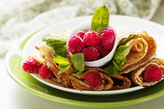 Pancakes with fresh raspberry. Pancake rolls with fresh raspberry and mint, selcetive focus Stock Photography