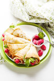 Pancakes with fresh raspberry. Pancake rolls with fresh raspberry and mint, selcetive focus top view Stock Images