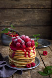 Pancakes with fresh raspberry and powdered sugar. Pancakes with fresh raspberry, rustic background Royalty Free Stock Image