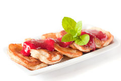Pancakes with fresh raspbery sauce and mint Stock Photos