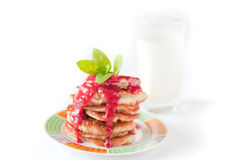 Pancakes with fresh raspbery sauce and mint Royalty Free Stock Photography