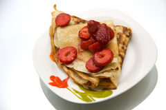 Pancakes with fresh strawberries Royalty Free Stock Photography