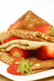 Pancakes with fresh strawberries Stock Images