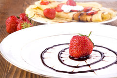 Pancakes with fresh strawberries and chocolate Royalty Free Stock Photography