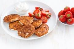 Pancakes with fresh strawberries and cream, horizontal Stock Photo