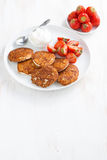 Pancakes with fresh strawberries and cream. Royalty Free Stock Photo