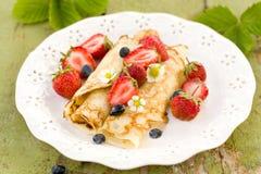 Pancakes with fresh strawberries Royalty Free Stock Photos