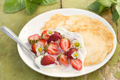 Pancakes with fresh strawberries Royalty Free Stock Photo