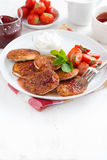 Pancakes with fresh strawberries, jam and tea. Stock Images
