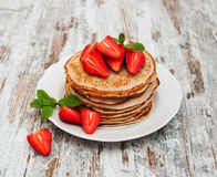 Pancakes with fresh strawberries Royalty Free Stock Image