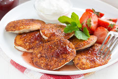 Pancakes with fresh strawberries on a plate Stock Photo