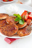 Pancakes with fresh strawberries on a plate, vertical Royalty Free Stock Photos