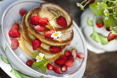 Pancakes with fresh strawberries. Red colors Royalty Free Stock Photos