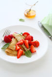 Pancakes with fresh strawberries Stock Photography