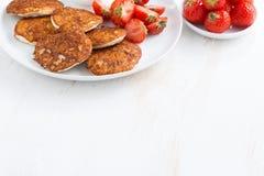 Pancakes with fresh strawberries. White wooden background Stock Photos