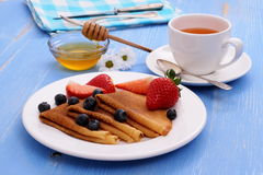 Pancakes with fresh strawberry blueberry and honey Royalty Free Stock Photos