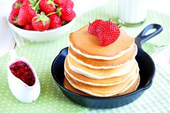 Pancakes with fresh strawberry  in a small pan Stock Image