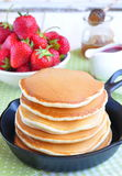 Pancakes with fresh strawberry  in a small pan Royalty Free Stock Photo