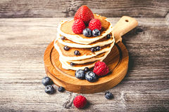 Pancakes with fresh summer berries Stock Images