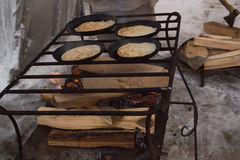 The pancakes are fried in a pan outdors - maslenitsa carnival. Close up Royalty Free Stock Photos